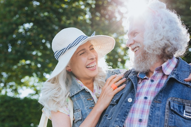 Happy together. joyful nice couple looking at each other while feeling happy together