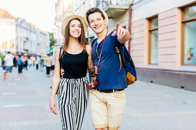Happy tourist couple in city