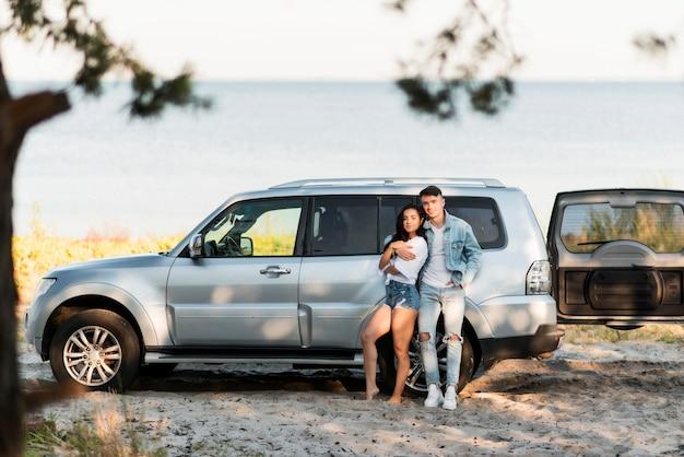 Happy tourist couple next to the sea