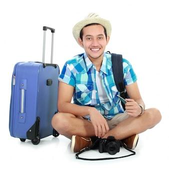 Happy tourist sitting on the floor