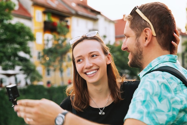 Happy tourists have fun and making selfie photo in old center of ljubljana slovenia