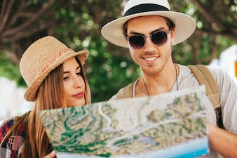 Happy tourists with map