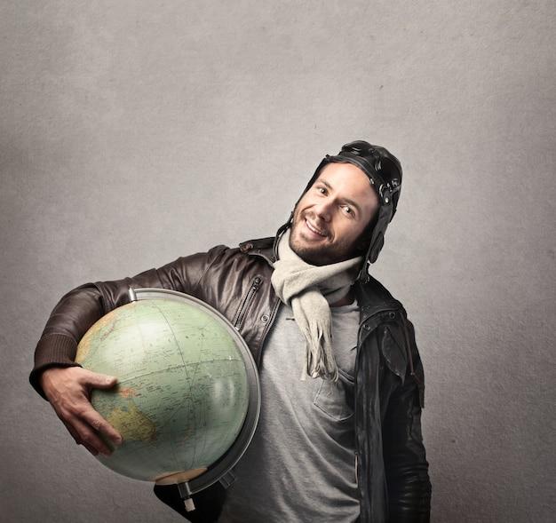 Happy traveler with a globe
