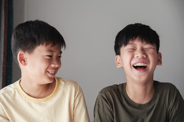 Happy tween boys laughing, having a great time together
