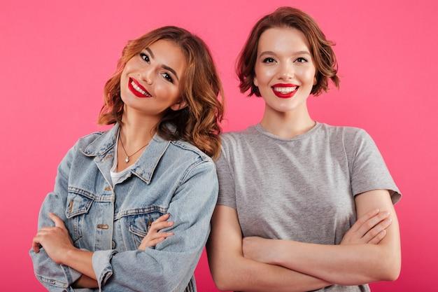 Happy two emotional women friends