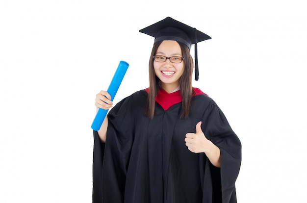 Happy university student in graduation gown and cap.