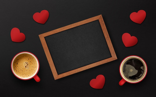 Happy valentine's day concept. cup of coffee on black wooden background
