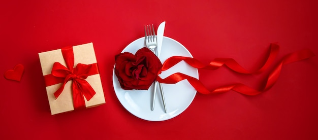 Happy valentine's day dinner, table setting with gift