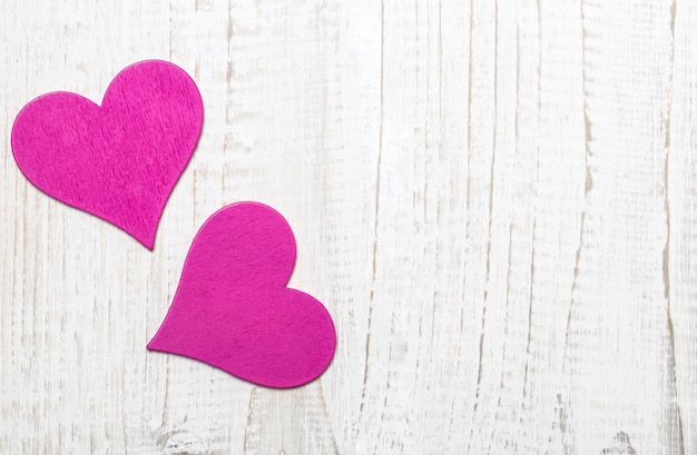 Happy valentine's day hearts on wooden table. valentine card