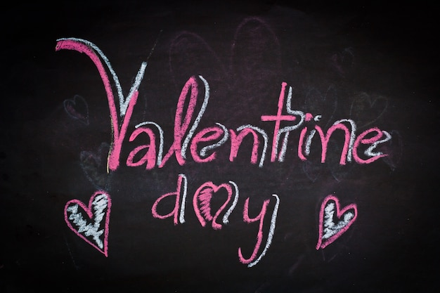 Happy valentines day on black board