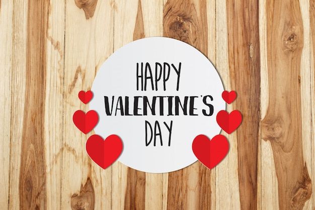 Happy valentines day message on paper on old wooden background