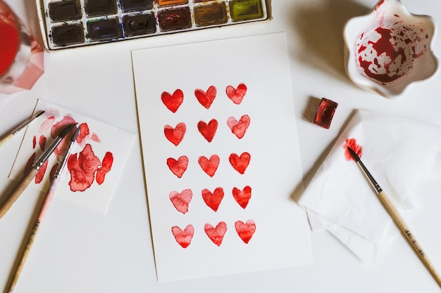 Happy valentines day or mothers day. love card with hearts painted with watercolor paints.
