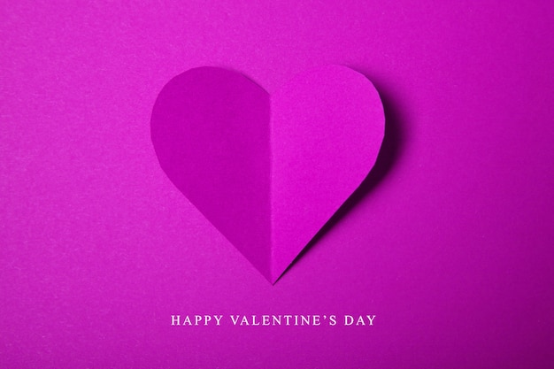 Happy valentines day, raspberry heart from paper. good holiday card.