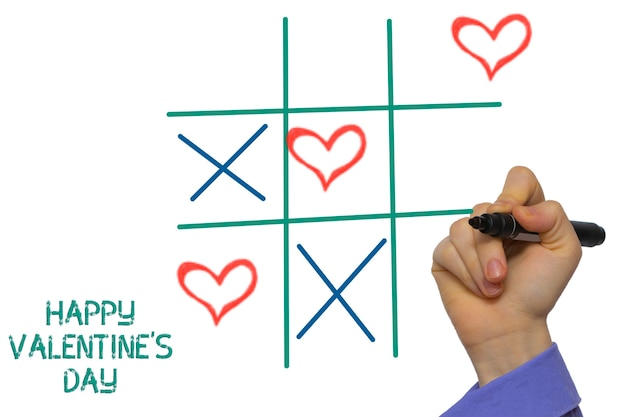 Happy valentines day tic-tac-toe by xoxo written on the white board Premium Photo