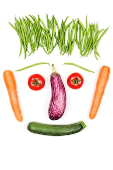 Happy vegetables face on white background