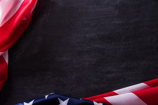 Happy veterans day. american flags veterans against a blackboard background.