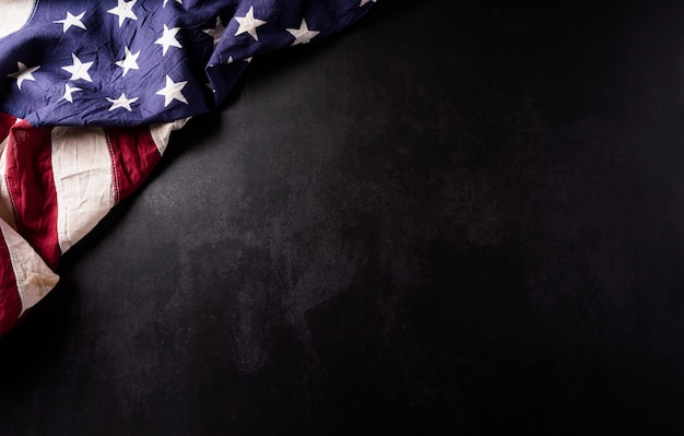 Happy veterans day concept vintage american flags against black  stone