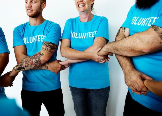 Happy volunteers united together
