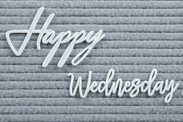 Happy weekdays poster written with letter symbols on the grey tissue