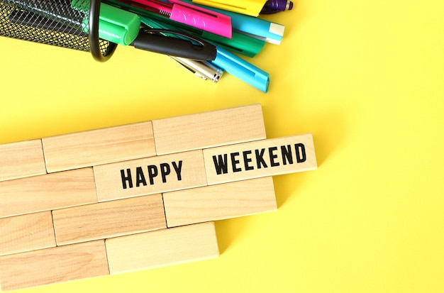 Happy weekend text on a wooden block