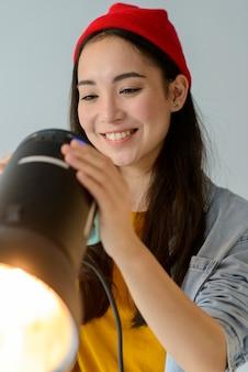 Happy woman adjusting light
