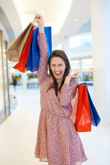 Happy woman after big shopping spree