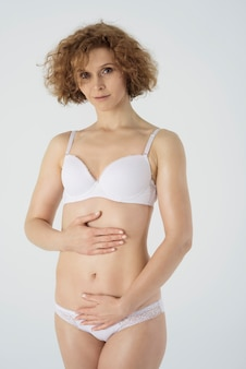 Happy woman in basic underwear isolated