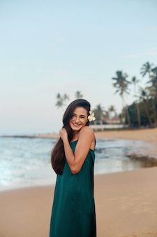 Happy woman on the beach  portrait of the beautiful girl young pretty girl young smiling woman outdoors portrait
