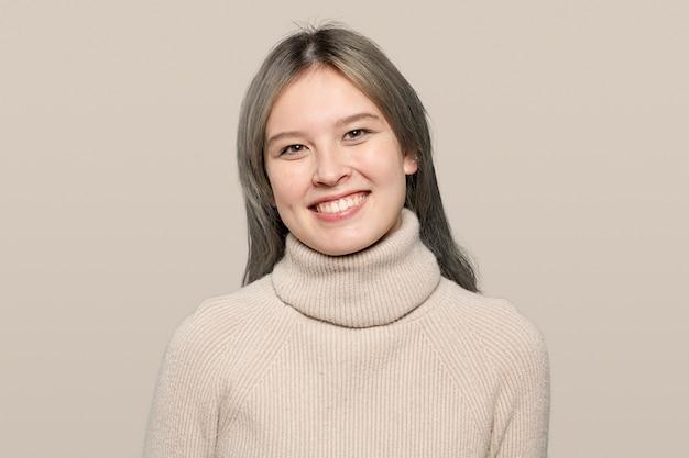 Happy woman in a beige sweater