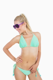 Happy woman in bikini wearing sunglasses