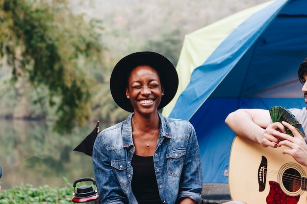 Happy woman at a campsite