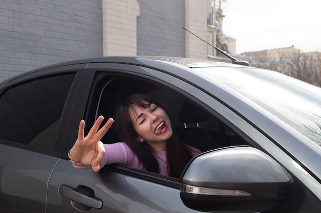 The happy woman in the car