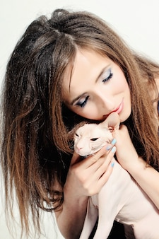 Happy woman and cat hairless sphynx