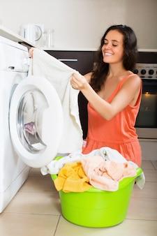 Happy woman cheking white clothes