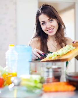 Happy  woman cooking dinner