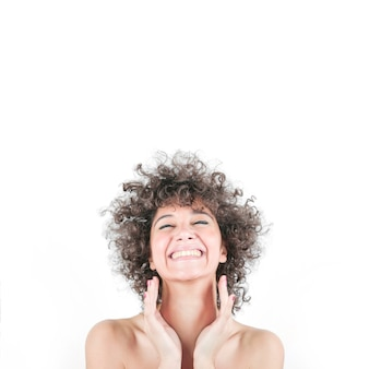 Happy woman in curly hair isolated over white background