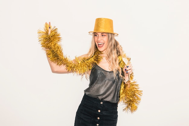 Happy woman dancing with bright tinsel