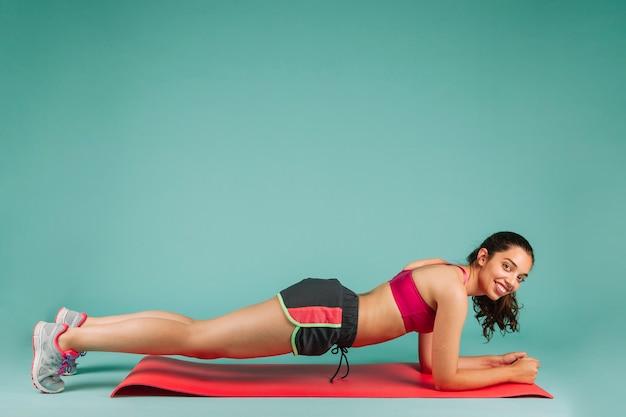 Happy woman doing push ups