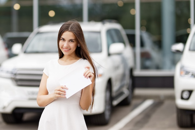 Happy woman driver showing car keys