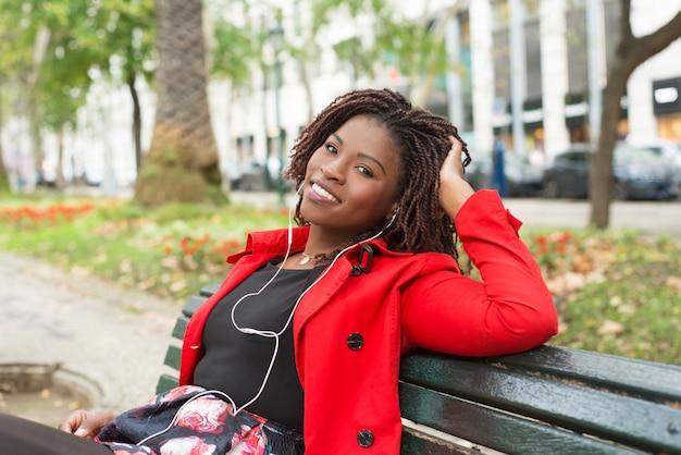 Happy woman in earphones smiling