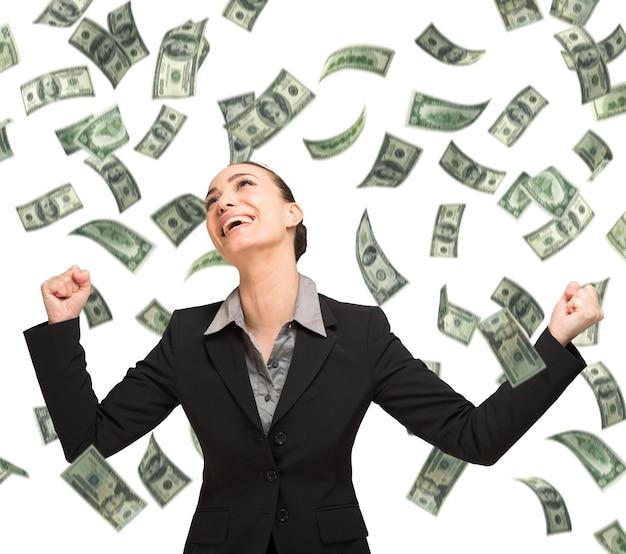Happy woman enjoying the rain of money
