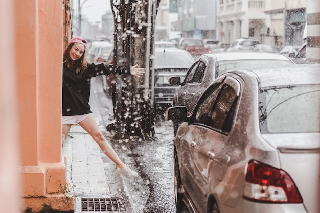 Happy woman enjoying the rain