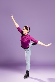 Happy woman fooling around in a studio