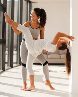 Happy woman and girl working out