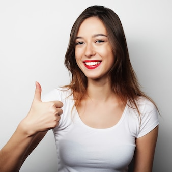 Happy woman giving thumb up. life style picture.