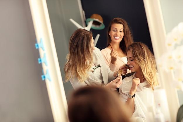 Happy woman in hair salon