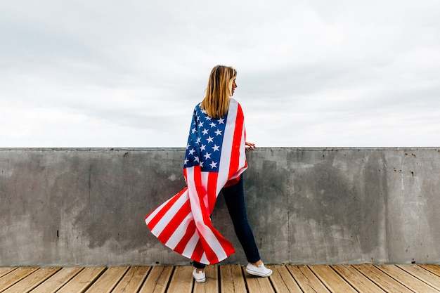 Happy woman holding an american flag