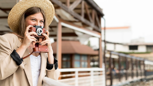 Happy woman holding camera