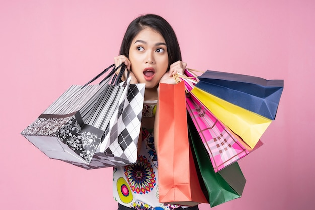 Happy woman holding colorful shopping bags
