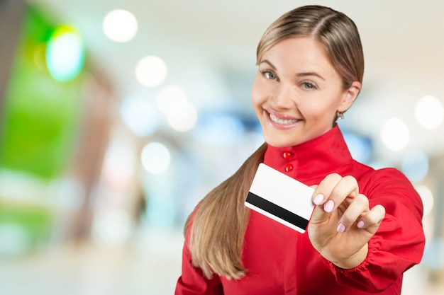Happy woman holding credit card. shopping concept